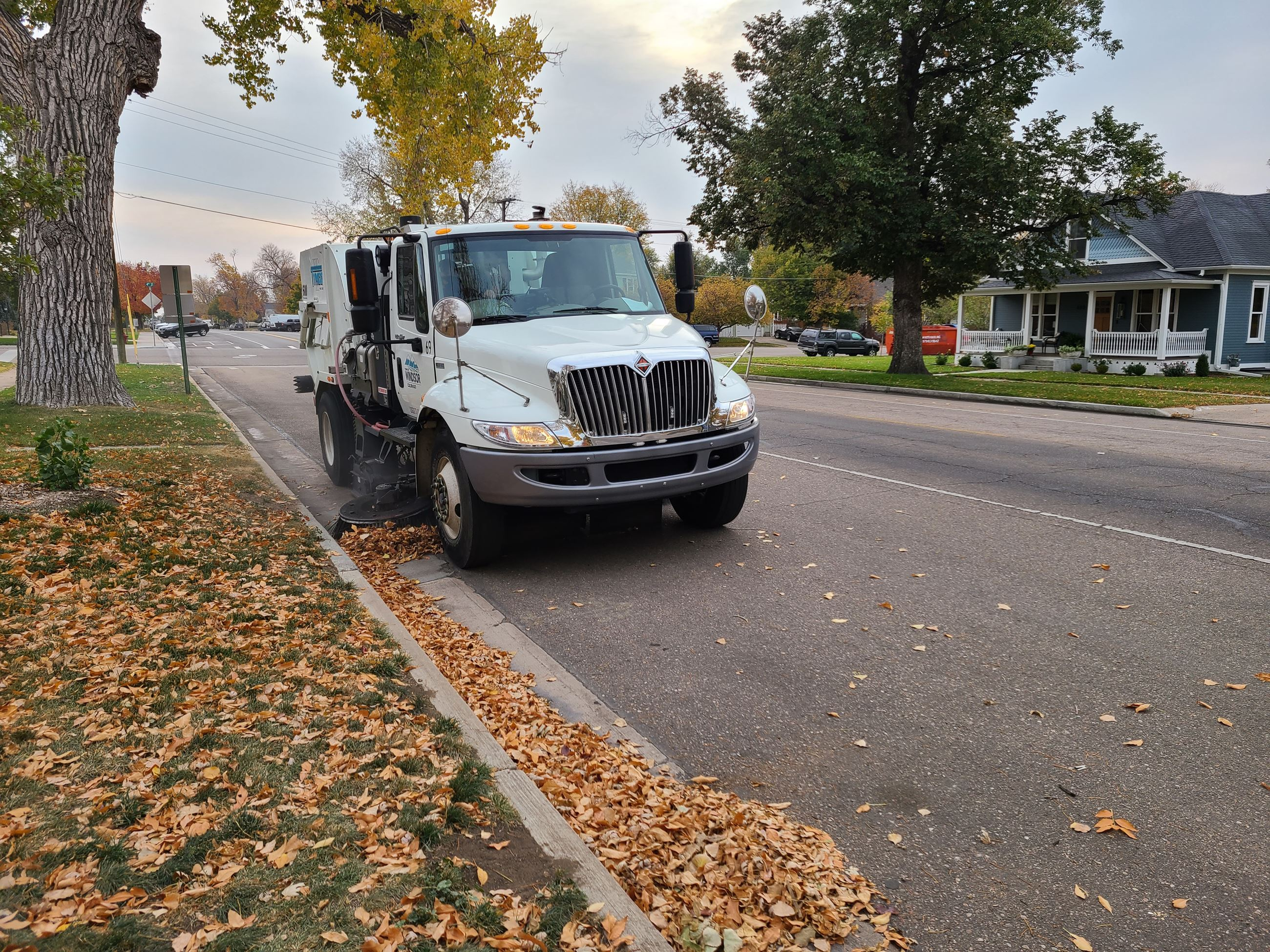 street sweeper on road during fall